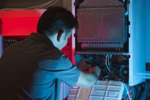 Technican work on boiler