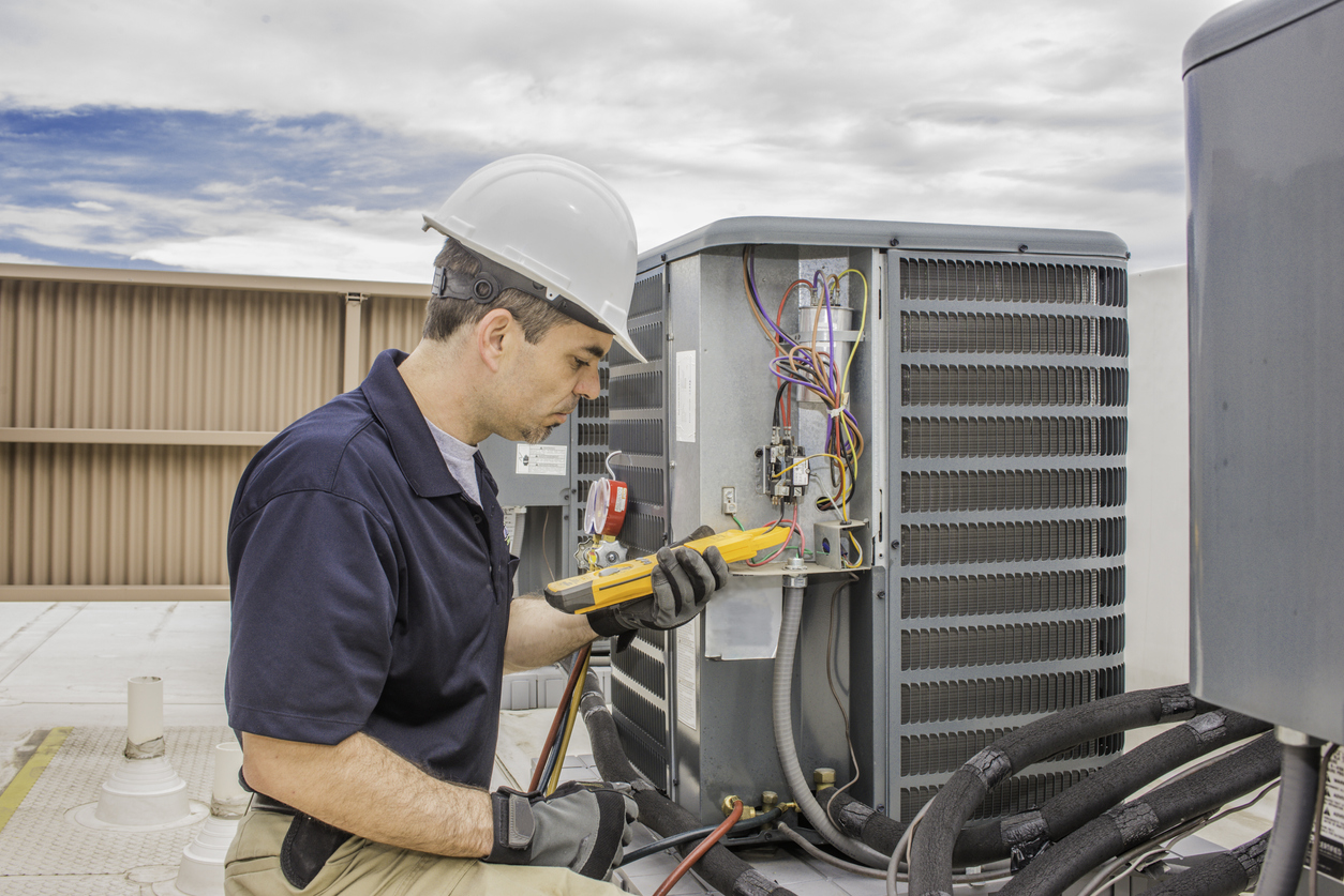 Hvac Tech working on a condensing unit